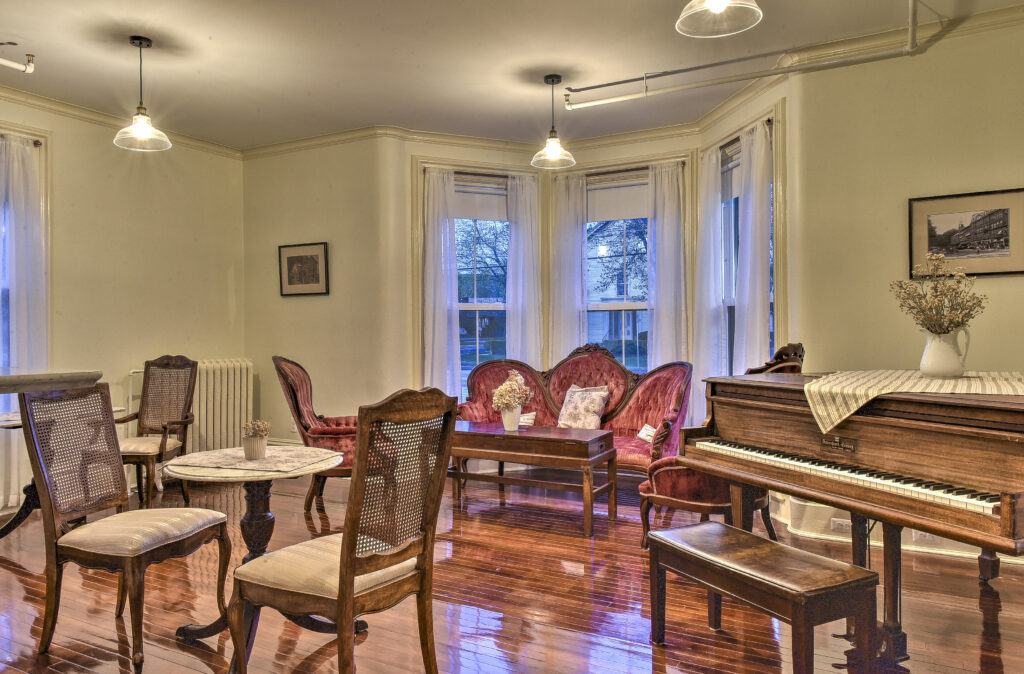 The Marble Room piano and lounge at The Burrell House Historical Inn Keene, New Hampshire